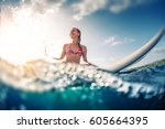 happy smiling woman sits on the ... | Shutterstock . vector #605664395
