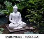 Statue Of Buddha On Wooden...