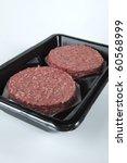 raw hamburger patties in a... | Shutterstock . vector #60568999