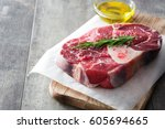 raw meat on wooden background  | Shutterstock . vector #605694665