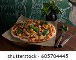 pizza with pumpkin  sun dried... | Shutterstock . vector #605704445