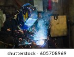 welders working at the factory... | Shutterstock . vector #605708969