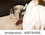 bottle of champagne and glasses ...   Shutterstock . vector #605754305