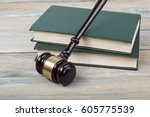 books and wooden judges gavel
