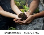 child is going to plant a tree | Shutterstock . vector #605776757