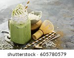 iced matcha latte with coconut...   Shutterstock . vector #605780579