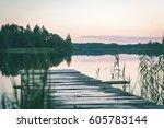 sunset over the river daugava... | Shutterstock . vector #605783144