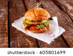 closeup of a burger piled with... | Shutterstock . vector #605801699