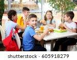 Children Sitting At Cafeteria...