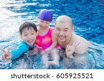 asian father and his children... | Shutterstock . vector #605925521