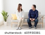 father and daughter sitting on... | Shutterstock . vector #605930381