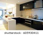 clean modern kitchen in a... | Shutterstock . vector #605930411