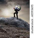 Businessman Carrying The Earth...