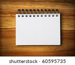 white blank note paper on rubber wood background - stock photo