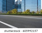 clean asphalt road with city... | Shutterstock . vector #605992157