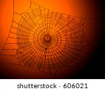 This is a high contrast image of a spider-web on a halloween style background. - stock photo