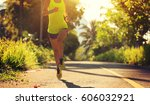 young fitness woman running on... | Shutterstock . vector #606032921