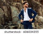 man in elegant suite posing in... | Shutterstock . vector #606034355