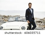 dude in suit with cool car ... | Shutterstock . vector #606035711