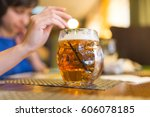 girl with a mug of beer in a... | Shutterstock . vector #606078185