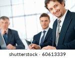 closeup of a young businessman... | Shutterstock . vector #60613339