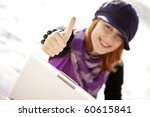 Portrait of red-haired girl with laptop at beach show OK symbol. - stock photo
