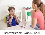 cute little boy at speech... | Shutterstock . vector #606164201