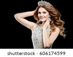 Small photo of Beautiful gorgeous young woman with luxurious hair with crown of beauty contest