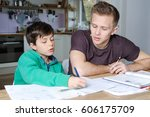 older brother is helping his... | Shutterstock . vector #606175709