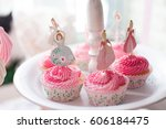 pink cremy cupcakes with... | Shutterstock . vector #606184475