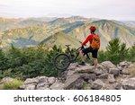 mountain biker looking at... | Shutterstock . vector #606184805