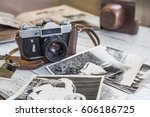 an old camera with black and... | Shutterstock . vector #606186725