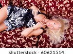 picture of sexy blonde on sofa | Shutterstock . vector #60621514