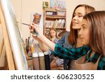 young teacher enjoying painting ... | Shutterstock . vector #606230525
