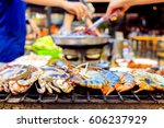 grill prawn cooking crabs... | Shutterstock . vector #606237929