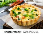 homemade quiche tart with red... | Shutterstock . vector #606243011