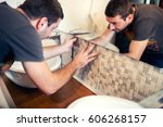 worker laying ceramic tiles ... | Shutterstock . vector #606268157