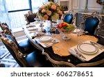 table set for a elegant dinner. | Shutterstock . vector #606278651