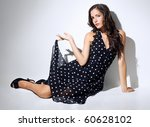 sensual woman in black dress - stock photo