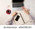 man showing a pen on a laptop... | Shutterstock . vector #606298154