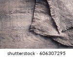 burlap texture on wooden table... | Shutterstock . vector #606307295