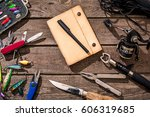 accessories for fishing on the... | Shutterstock . vector #606319685