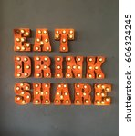 eat and drink neon sign for... | Shutterstock . vector #606324245
