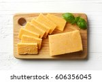 cutting board of cheddar cheese ... | Shutterstock . vector #606356045