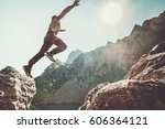 man jumping to the sun in rocky ... | Shutterstock . vector #606364121