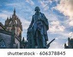 Small photo of The monument of Adam Smith on The Royal Mile. Edinburgh, Scotland, UK