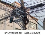 Many Electrical Wires On Pilla...