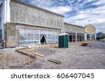 a new retail strip center under ... | Shutterstock . vector #606407045