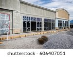 a new retail strip center under ... | Shutterstock . vector #606407051