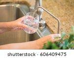 woman pouring fresh reverse... | Shutterstock . vector #606409475